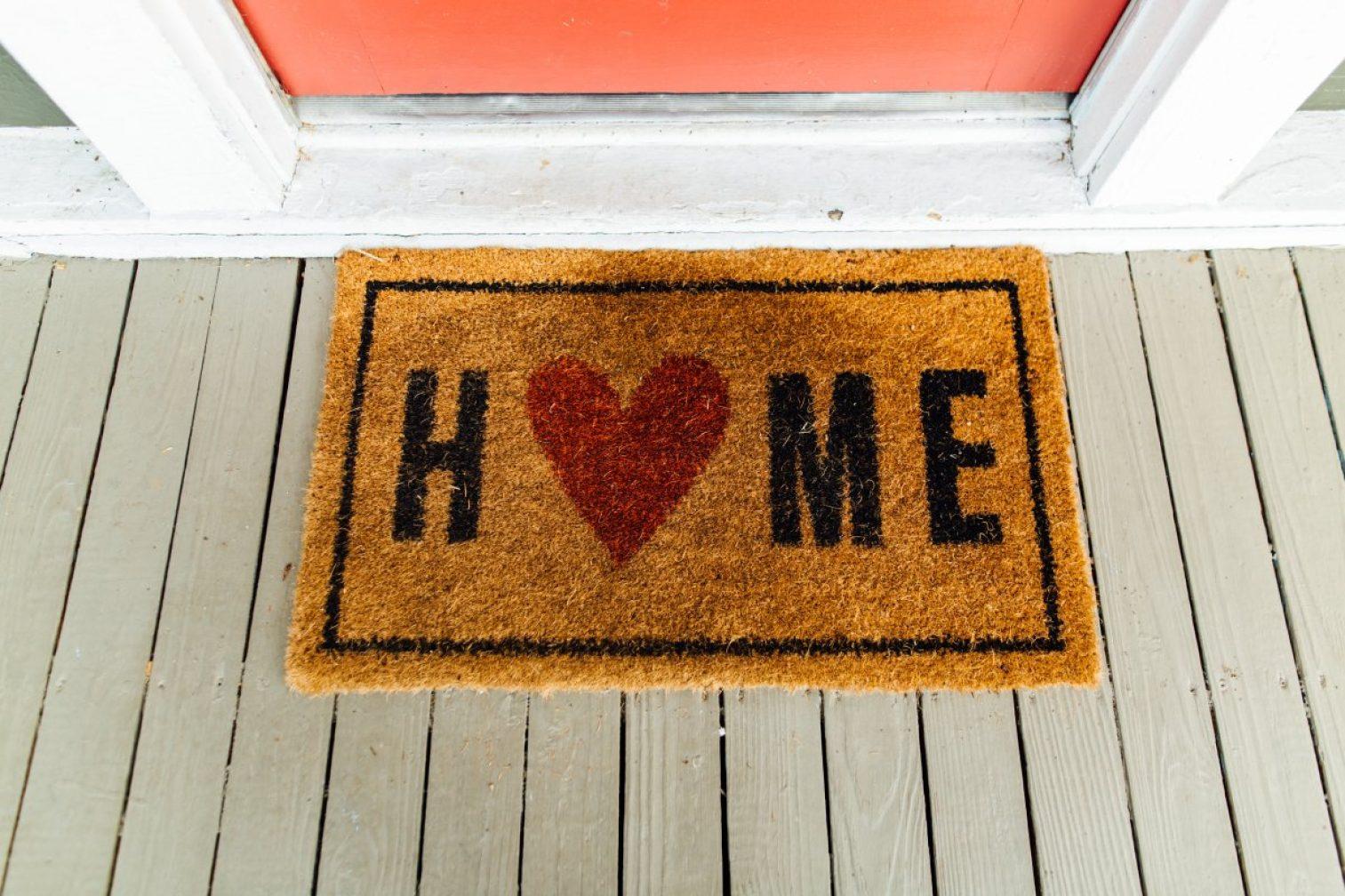 Brown home printed rug beside door