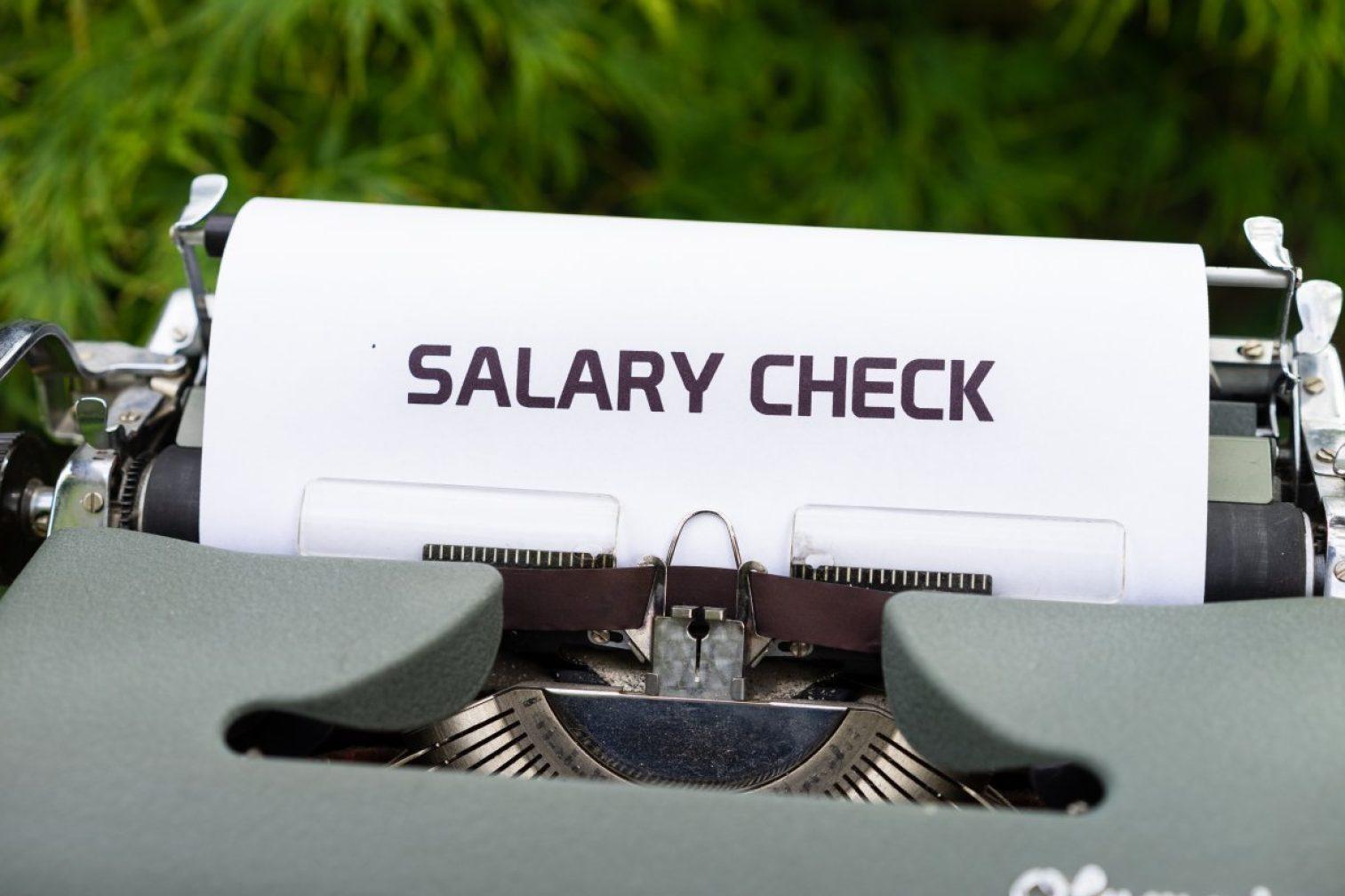 typewriter, salary check, money
