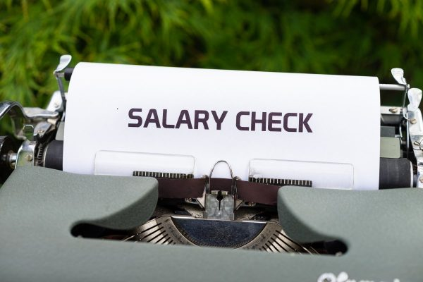 typewriter, salary check, money