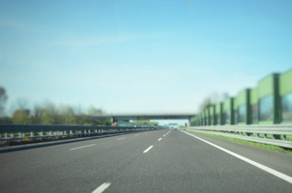 Gray asphalt road under blue sky