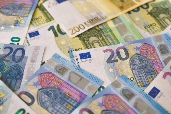 A pile of Euro (EUR) banknotes that include 20, 100, and 200 notes. ( Part II)