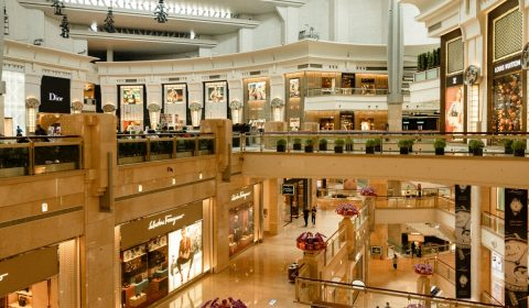 Modern style shopping center with shiny floor and many boutiques