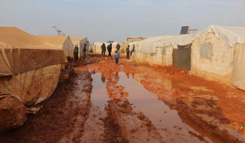 People walking in refugee camp