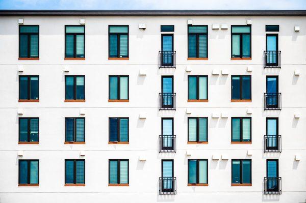 Exterior of modern white residential condominium